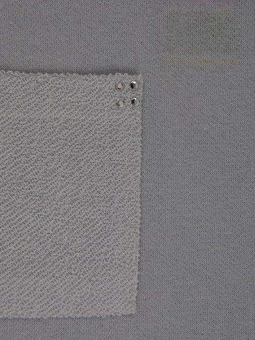 Dzianinowa bluzka z ozdobną kieszenią 18011.
