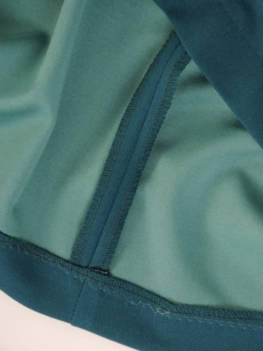 Luźna, zielona sukienka maskująca wszelkie niedoskonałości 27925