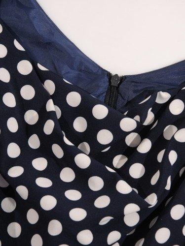 """Rozkloszowana sukienka w groszki 16627, modna kreacja z dekoltem typu """"woda""""."""