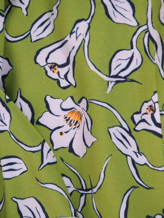 Zielona spódnica z ukośną falbaną 30071
